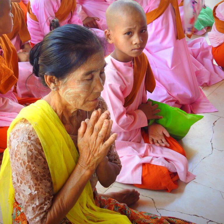 Myanmar - old praying lady
